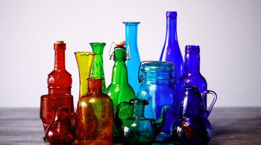 colored glass bottles on table